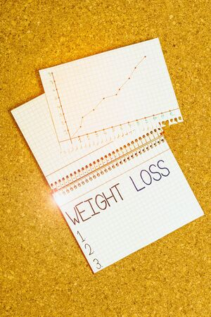 Text sign showing Weight Loss. Business photo showcasing the fact of a demonstrating or animals body weight becoming less Desk notebook paper office cardboard paperboard study supplies table chart