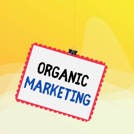 Writing note showing Organic Marketing. Business concept for getting your customers to come to you naturally over time Stamp stuck binder clip square color frame rounded tip Standard-Bild