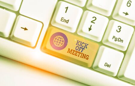 Conceptual hand writing showing Kick Off Meeting. Concept meaning getting fired from your team private talking about company White pc keyboard with note paper above the white background