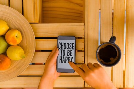 Writing note showing Choose To Be Happy. Business concept for Decide being in a good mood smiley cheerful glad enjoy woman with laptop smartphone and office supplies technology Stock Photo