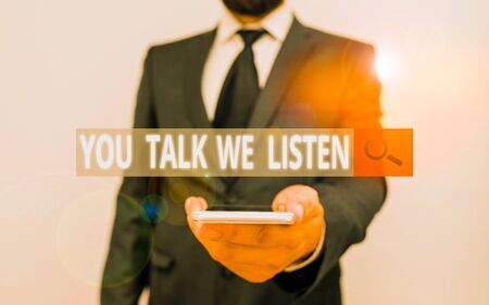 Word writing text You Talk We Listen. Business photo showcasing Two Way Communication Motivational Conversation Male human wear formal work suit hold smart hi tech smartphone use one hand