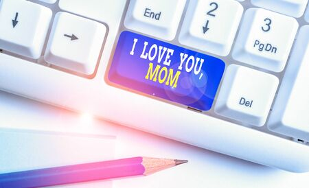 Writing note showing I Love You Mom. Business concept for Loving message emotional feelings affection warm declaration White pc keyboard with note paper above the white background