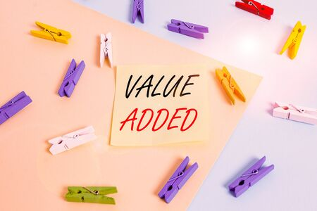 Word writing text Value Added. Business photo showcasing the extra value created over and above the original value Colored clothespin paper empty reminder yellow blue floor background office Standard-Bild