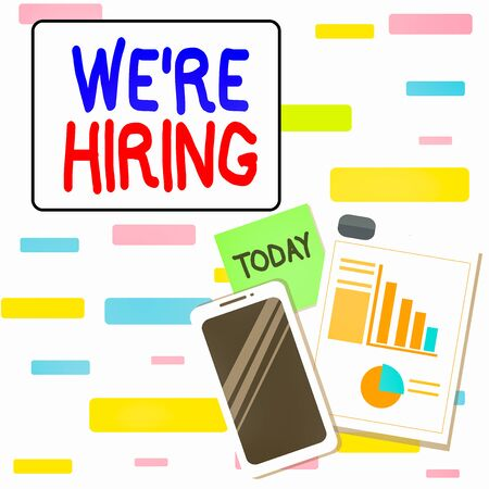 Writing note showing We Re Hiring. Business concept for recently employ someone or pay him to do particular job Layout Smartphone Sticky Notes with Pie Chart and Bar Graph Stock Photo