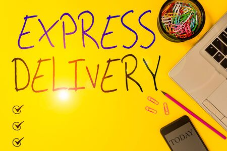 Text sign showing Express Delivery. Business photo showcasing expediting the distributiuon of goods and services Slim trendy laptop pencil smartphone clips container colored background
