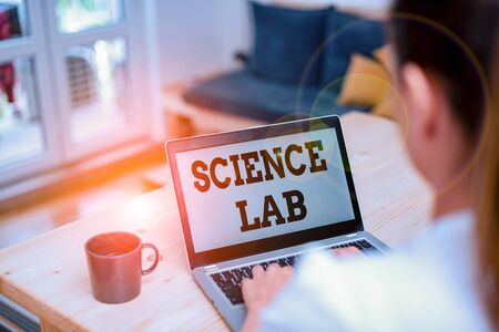 Writing note showing Science Lab. Business concept for special facility where experiments are done and with equipment woman laptop computer office supplies technological devices inside home Imagens