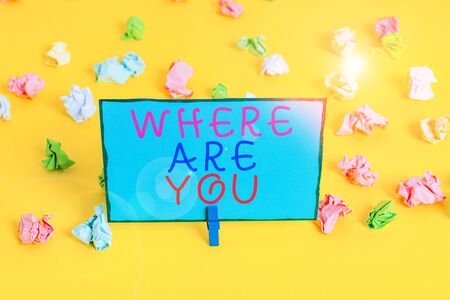 Text sign showing Where Are You. Business photo showcasing Give us your location address direction point of reference Colored crumpled papers empty reminder white floor background clothespin Banco de Imagens