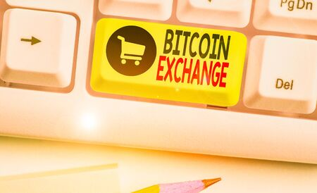 Conceptual hand writing showing Bitcoin Exchange. Concept meaning digital marketplace where traders can buy and sell bitcoins Imagens