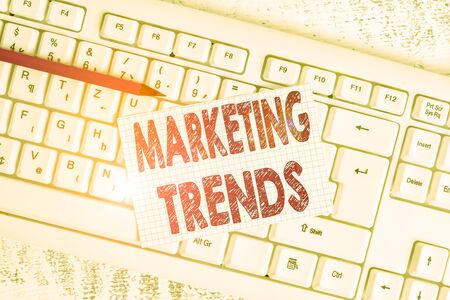 Word writing text Marketing Trends. Business photo showcasing changes and developments in trading in the market White keyboard office supplies empty rectangle shaped paper reminder wood