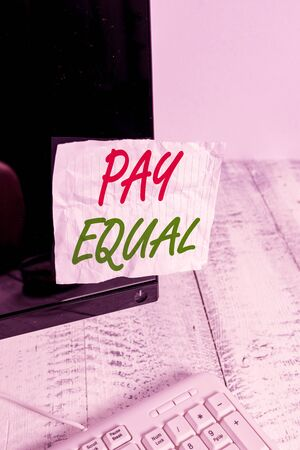 Handwriting text Pay Equal. Conceptual photo Principle of nondiscrimination in compensation for work Notation paper taped to black computer monitor screen near white keyboard