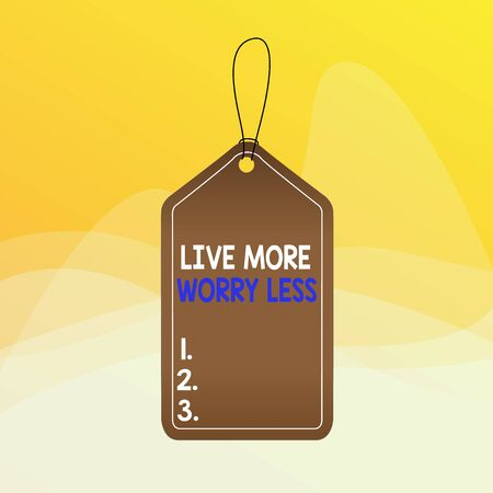 Writing note showing Live More Worry Less. Business concept for Have a good attitude motivation be careless enjoy life Empty tag colorful background label rectangle attach string