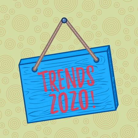 Handwriting text writing Trends 2020. Conceptual photo general direction in which something is developing or changing Square rectangle unreal cartoon wood wooden hang down on the coloured wall