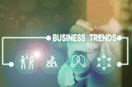 Writing note showing Business Trends. Business concept for a general change in the way business is developing