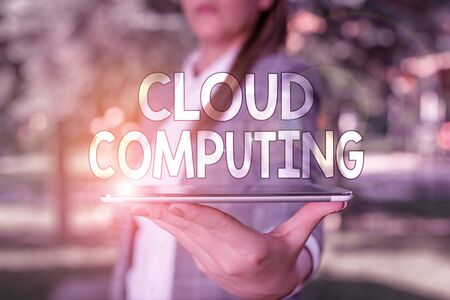 Conceptual hand writing showing Cloud Computing. Concept meaning storing and accessing data and programs over the Internet Outdoor scene with business woman holds lap top with touch screen