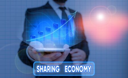 Conceptual hand writing showing Sharing Economy. Concept meaning collaborative consumption or peer to peer based sharing