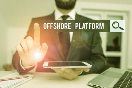 Conceptual hand writing showing Offshore Platform. Concept meaning structure with facilities for well drilling to explore Male human wear formal clothes present use hitech smartphone
