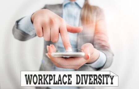 Conceptual hand writing showing Workplace Diversity. Concept meaning environment that accepts each individual differences Business woman points with finger on touch screen