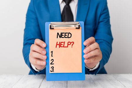 Writing note showing Need Helpquestion. Business concept for to give or provide what is necessary to accomplish a task Man holds empty paper with copy space in front of him Space