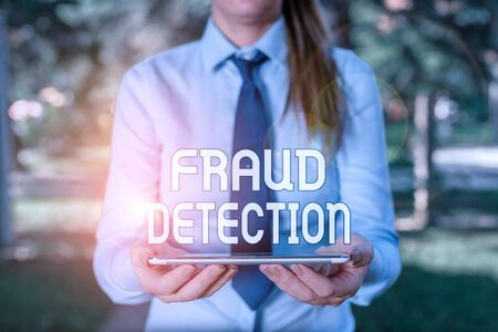 Text sign showing Fraud Detection. Business photo showcasing identification of actual or expected fraud to take place Business woman in shirt with a tie holding lap top mobile phone in the hand