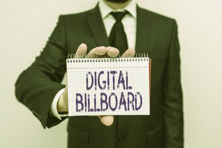 Handwriting text writing Digital Billboard. Conceptual photo billboard that displays digital images for advertising Male human wear formal work suit office look hold mathematics book use hand