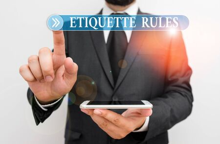 Word writing text Etiquette Rules. Business photo showcasing customs that control accepted behaviour in social groups Male human wear formal work suit hold smart hi tech smartphone use one hand