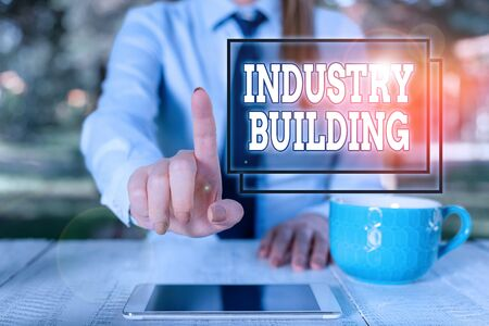 Writing note showing Industry Building. Business concept for Factories and other premises used for analysis manufacturing Business woman sitting by the table with cup of coffee and mobile phone
