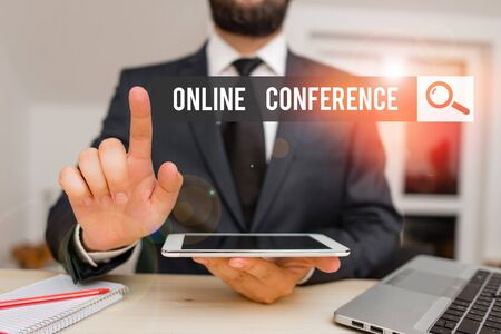 Conceptual hand writing showing Online Conference. Concept meaning online service by which you can hold live meetings Male human wear formal clothes present use hitech smartphone Foto de archivo