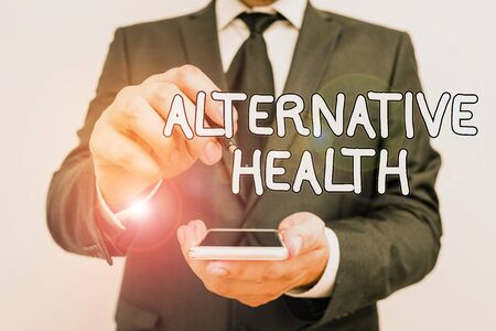 Handwriting text Alternative Health. Conceptual photo products and practices that are not part of standard care Male human wear formal work suit hold smart hi tech smartphone use one hand Stock Photo