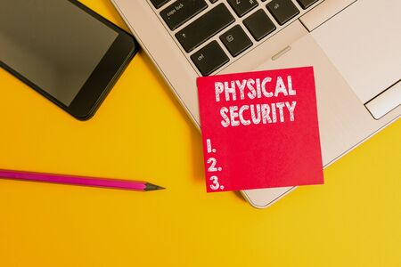 Handwriting text Physical Security. Conceptual photo designed to deny unauthorized access to facilities Trendy laptop smartphone blank sticky note pencil marker colored background