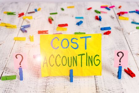 Conceptual hand writing showing Cost Accounting. Concept meaning the recording of all the costs incurred in a business Crumbling sheet with paper clips placed on the wooden table Stock fotó