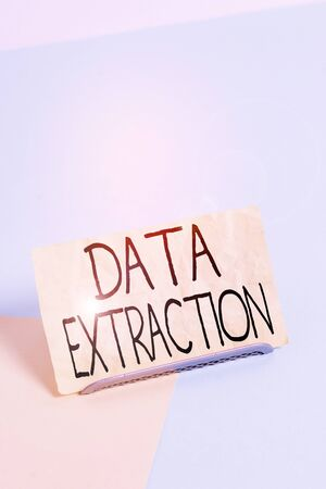 Conceptual hand writing showing Data Extraction. Concept meaning act or process of retrieving data out of data sources Paper on buffer wire on soft pastel multi colours backdrop Stock Photo