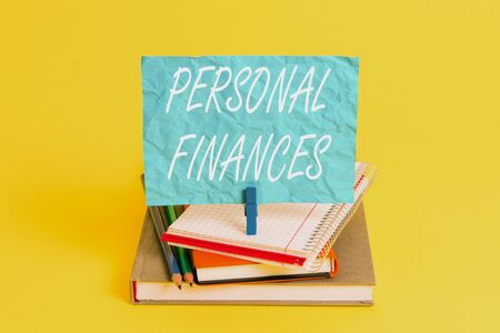 Word writing text Personal Finances. Business photo showcasing the activity of analysing own money and financial decisions Book pencil rectangle shaped reminder notebook clothespin office supplies