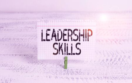 Writing note showing Leadership Skills. Business concept for Skills and qualities that leaders possess Taking a lead Green clothespin white wood background reminder office supply