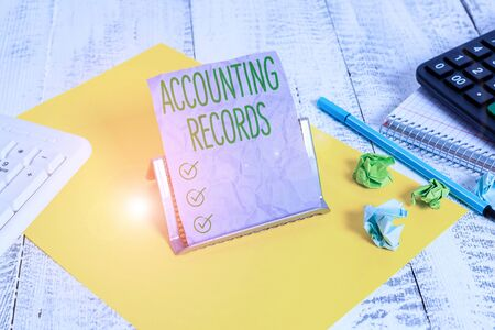 Handwriting text Accounting Records. Conceptual photo Manual or computerized records of assets and liabilities Notepaper stand on buffer wire in between computer keyboard and math sheets