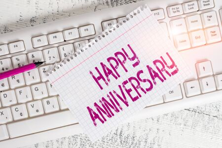 Writing note showing Happy Anniversary. Business concept for The annually recurring date of a past event celebration Keyboard office supplies rectangle shape paper reminder wood 写真素材