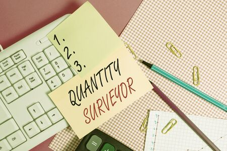 Text sign showing Quantity Surveyor. Business photo showcasing calculate the cost of the materials and work needed Note paper stick to computer keyboard near colored gift wrap sheet on table