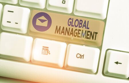 Writing note showing Global Management. Business concept for way an organization analysis its business internationally 版權商用圖片