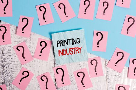 Writing note showing Printing Industry. Business concept for industry involved in production of printed matter Scribbled and crumbling papers with thick cardboard above wooden table Stockfoto
