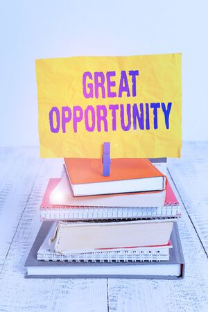 Text sign showing Great Opportunity. Business photo showcasing an appropriate or favorable time or occasion to venture pile stacked books notebook pin clothespin colored reminder white wooden