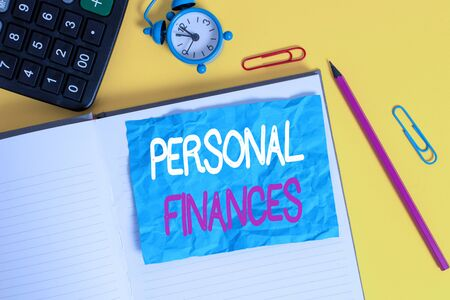 Conceptual hand writing showing Personal Finances. Concept meaning the activity of analysing own money and financial decisions Notebook calculator pencil crushed sheet color background