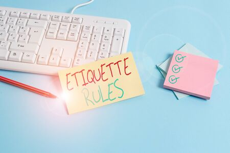 Conceptual hand writing showing Etiquette Rules. Concept meaning customs that control accepted behaviour in social groups Paper blue keyboard office study notebook chart numbers memo