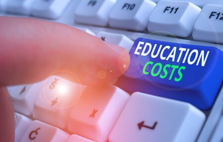 Writing note showing Education Costs. Business concept for amounts paid for tuition fees and other related expenses Archivio Fotografico