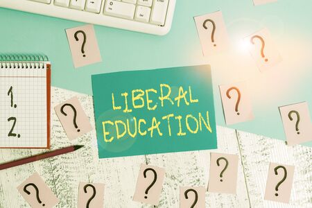 Word writing text Liberal Education. Business photo showcasing education suitable for cultivation of free huanalysis being Writing tools, computer stuff and math book sheet on top of wooden table Stok Fotoğraf