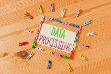 Word writing text Data Processing. Business photo showcasing collection and manipulation of items of data to produce Colored clothespin papers empty reminder wooden floor background office