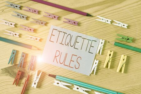 Text sign showing Etiquette Rules. Business photo text customs that control accepted behaviour in social groups Colored clothespin papers empty reminder wooden floor background office