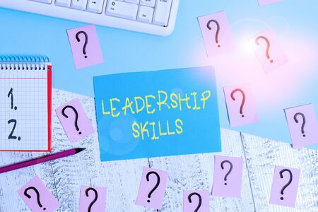Word writing text Leadership Skills. Business photo showcasing Skills and qualities that leaders possess Taking a lead Writing tools, computer stuff and math book sheet on top of wooden table