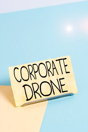 Conceptual hand writing showing Corporate Drone. Concept meaning unmanned aerial vehicles used to monitor business vicinity Paper on buffer wire on soft pastel multi colours backdrop