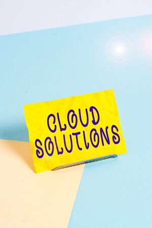 Handwriting text writing Cloud Solutions. Conceptual photo ondemand services or resources accessed via the internet Paper placed tilted above buffer wire on soft pastel multi colours backdrop