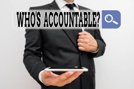 Word writing text Who S Accountable. Business photo showcasing answerable for something within one power or control Male human wear formal work suit hold smart hi tech smartphone use one hand