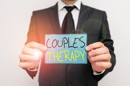 Conceptual hand writing showing Couple S Therapy. Concept meaning treat relationship distress for individuals and couples Male human wear formal work suit with office look hold book